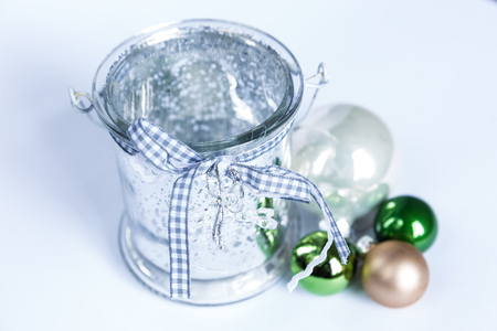 Composition of the Christmas green balls and candle isolated on white background