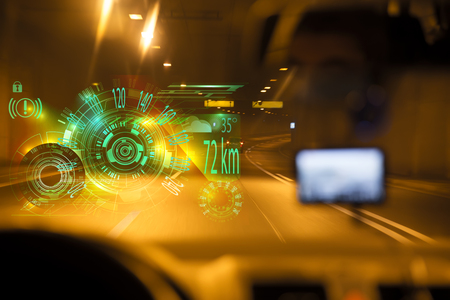 car driving through tunnel highway tunnel at night.car HUD dashboard. Futuristic user interface HUD and Infographic elements. Abstract virtual graphic touch user interface. Stock Photo