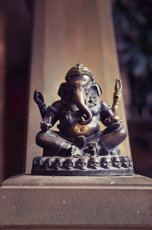 Hindu God Ganesh statue idol, Lord Ganesh the Remover of Obstacles and the god of success.Buddhism Elephant Ganesha God of Wealth Statue. Hindu religion concept