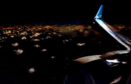 Airplane in night sky. Night airplane