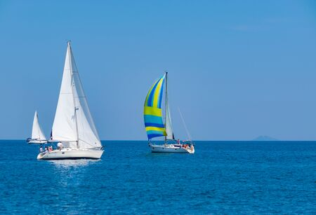 Sailing regatta in blue sea at sunny day. Yachting adventure concept. Space for text Stock fotó