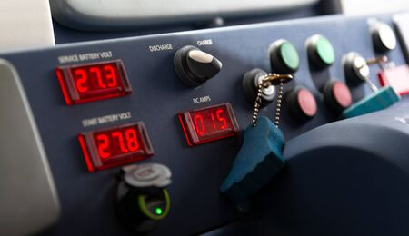 Instruments and gauges on a dashboard used by a boat captain when steering the vessel from the lower deck on yacht Stockfoto