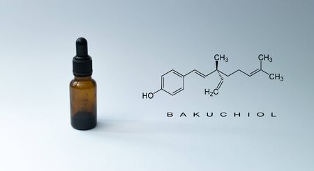 """Bottle with pipette and chemical formula with text """"BAKUCHIOL"""" on green background. - Bakuchiol retinol alternative concept. Reklamní fotografie"""