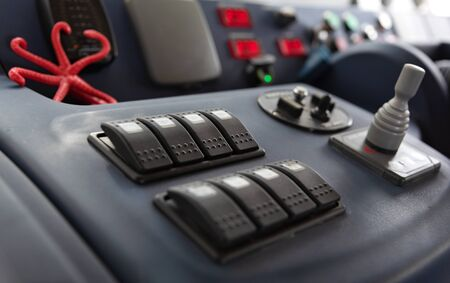 Instruments and gauges on dashboard used by boat captain when steering vessel from lower deck on motor yacht