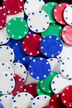 Poker Chips on Black Background photo