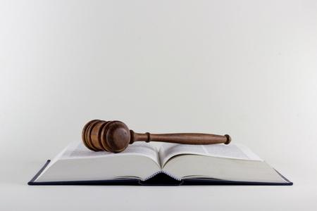 atop: Gavel atop Legal Texts