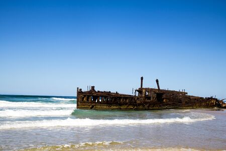 Photograph of the shipwreck of the SS Maheno on Fraser Island with a cloudless sky in the background. Fraser Island is located off Queensland in eastern Australia Reklamní fotografie