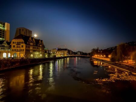 Long exposure of the Limmat river in Zurich during a full moon night. Stockfoto