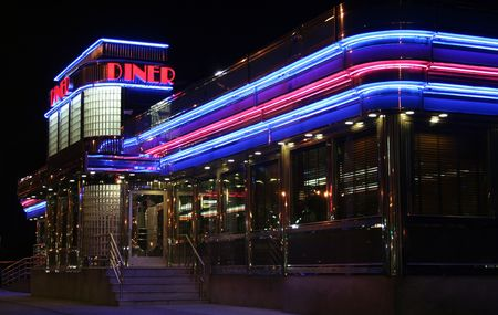 neon sign: Neon lights on diner light up night Stock Photo