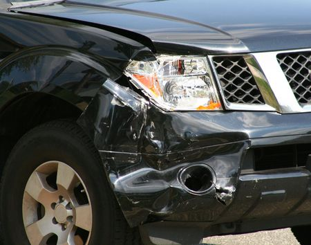 collision: front end damage to black luxury suv Stock Photo
