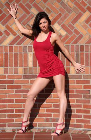woman posing in short red dress