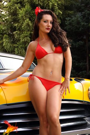 pin up model posing with flamed hot rod Stock Photo - 5340963