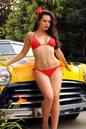hot rod: pin up model posing with flamed hot rod
