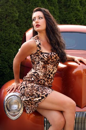 custom car: Pin up model posing with vintage hot rod