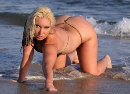 thongs: blond in black thong bikini crawling in the surf