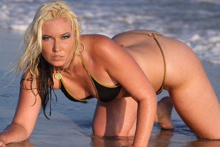 thong bikini: blond in black thong bikini crawling in the surf