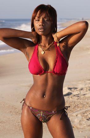 young african american woman posing in bikini on beach photo