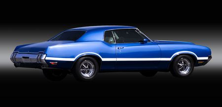Vintage blue muscle car with white stripes