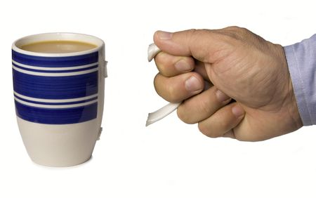 tried: mans hand holding handle of coffee mug that broke off when he tried to pick up mug Stock Photo