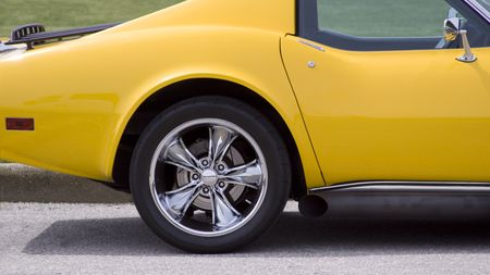 reflect: custom wheel and side pipe on yellow sports car