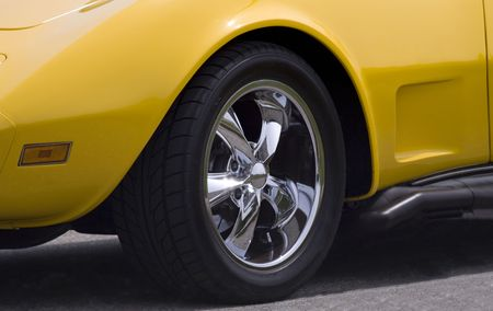 custom wheel and side pipe on yellow sports car photo