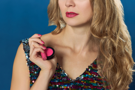 st  valentine: St Valentine day blond woman holding pink cosmetics party time Stock Photo
