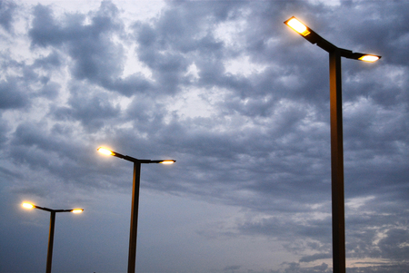 Street light lamppost against a cloudy sky