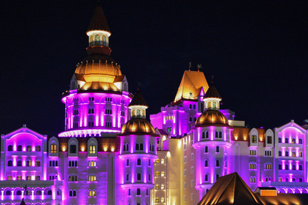 Beautiful luminous building, the castle (bogatyr in the city of Sochi, Russian Federation), purple and yellow