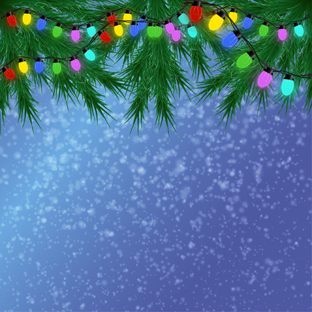 For Christmas card on a blue background, with falling snow on top of the branches of spruce with multi-colored garland