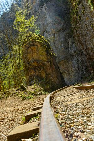 Rail road along the rocks and trees, beautiful nature, rich colors