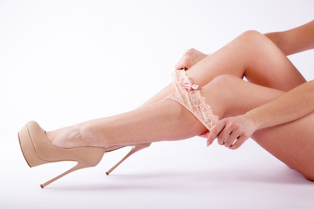 tanga: Womans legs in shoes with panty