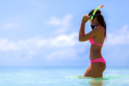 Maldives a woman with a snorkel mask Stock Photo