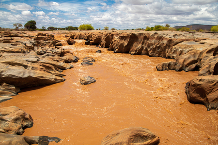 Galana river in Kenya, blue sky with clouds Stock Photo