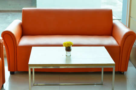 carpet clean: Orange sofa in wellcome office room