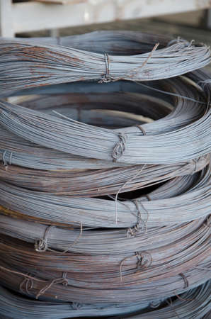 aluminum rod: Close-up of stainless steel wire coils in warehouse