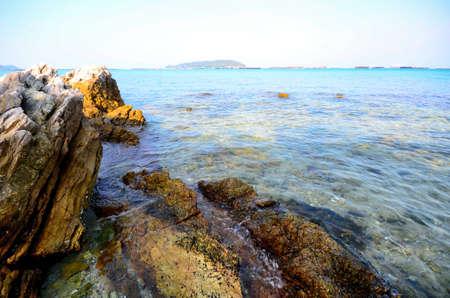Rocks at sea and ship Stock Photo