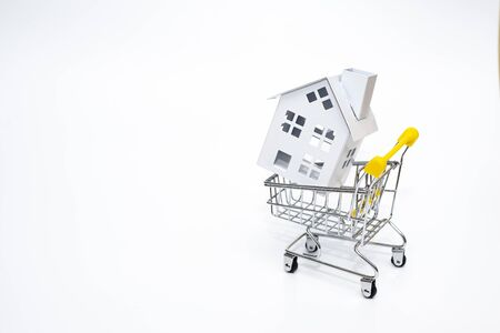 Mini home on trolley cart concept for sale home or rent white copy space.