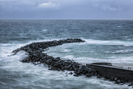 unsettled: San Seb breakwall Stock Photo