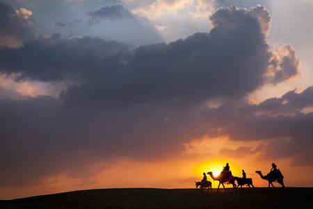 the middle: Camel, Donkey train