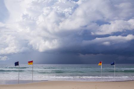 australia beach: Swimming flags Stock Photo