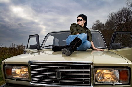 portrait of the woman with car on nature photo