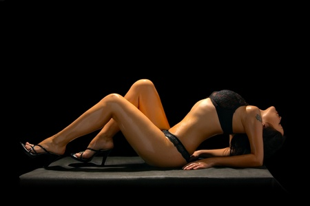 seductive brunette in underclothes isolated on black background Stock Photo - 8814662