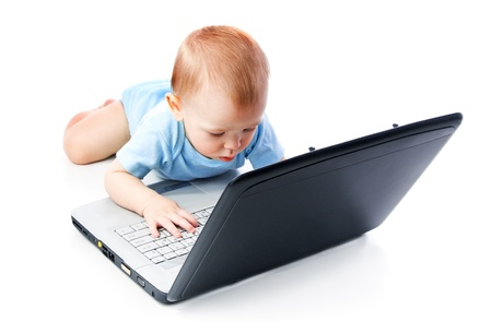 Infant using laptop over white Stock Photo - 8815566