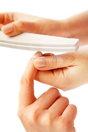 Studio nail - beautician polishing nails Stock Photo - 8828133