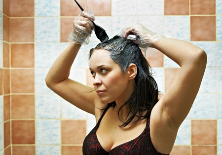 pretty beautiful young woman dyeing hairs Stock Photo - 8840638