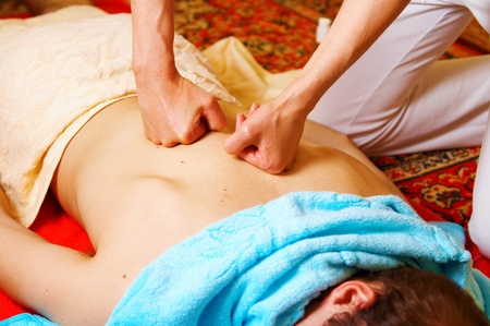 traditional clothes: Thai massage is a type of massage in Thai style that involves stretching and deep massage.