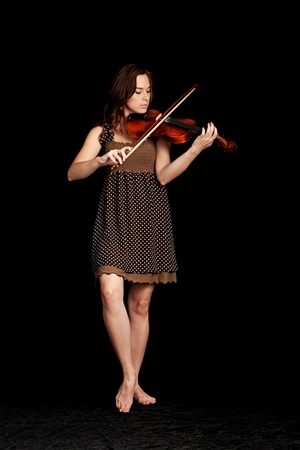 violinist isolated on black background Stock Photo - 8814930
