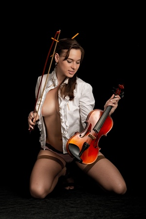 violinist isolated on black background Stock Photo - 8815477