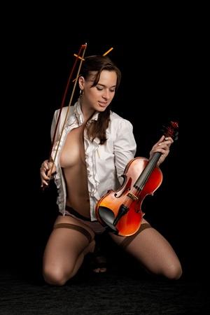 fiddlestick: violinist isolated on black background