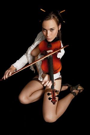 violinist isolated on black background Stock Photo - 8827160